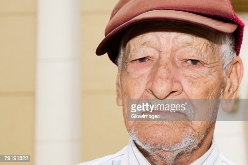 Portrait of a senior man wearing a flat cap : Stock Photo
