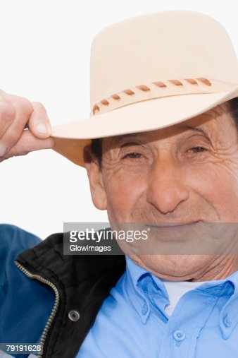 Portrait of a senior man wearing a hat and smiling : Foto de stock