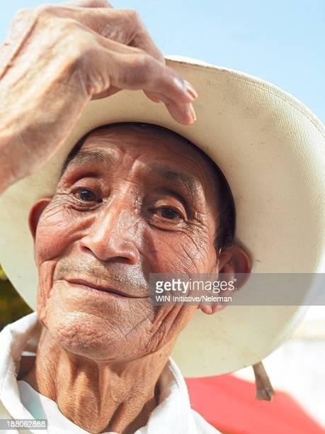 Portrait of a senior man wearing a hat