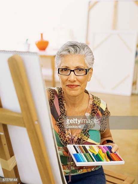 Portrait of a senior woman drawing