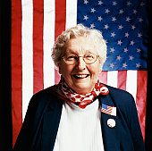 Portrait of a Senior Woman in Front of Stars and Stripes Flags