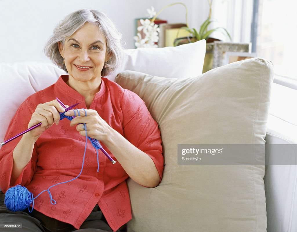 portrait of a senior woman knitting