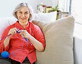 portrait of a senior woman knitting