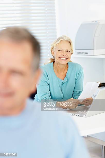 Portrait of a senior woman paying the bills