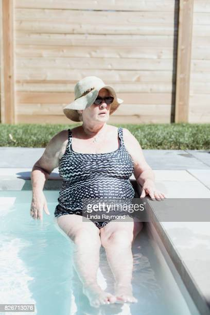 Portrait of a senior woman relaxing in a pool