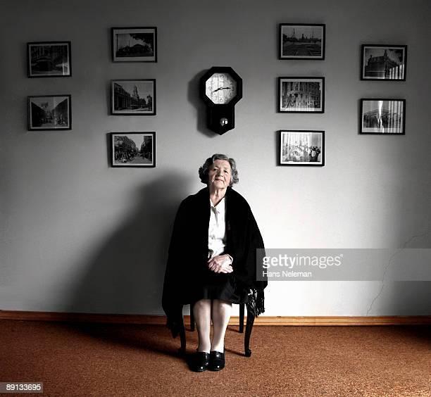 Portrait of a senior woman sitting on a chair, Santiago, Chile