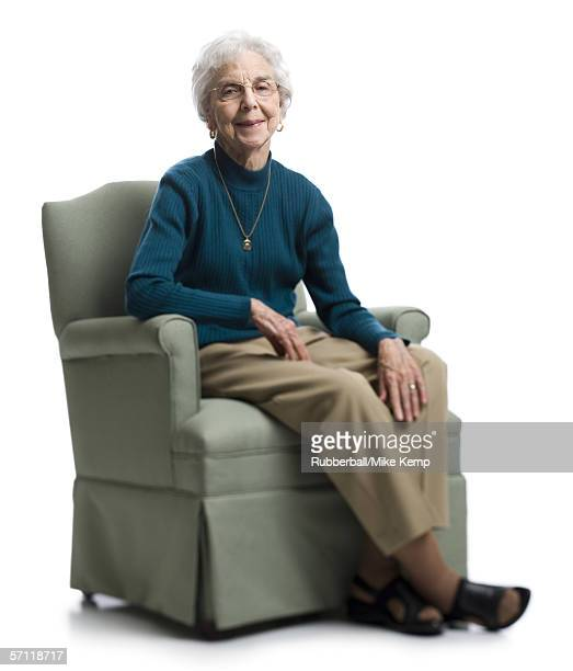 Portrait of a senior woman sitting on an armchair