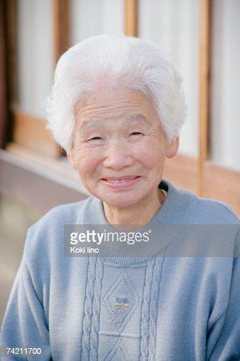 Portrait of a senior woman smiling : Stock Photo
