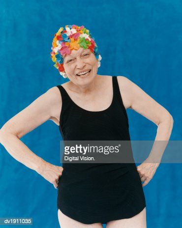 Portrait Of A Senior Woman Standing In A Swimming Costume With Her