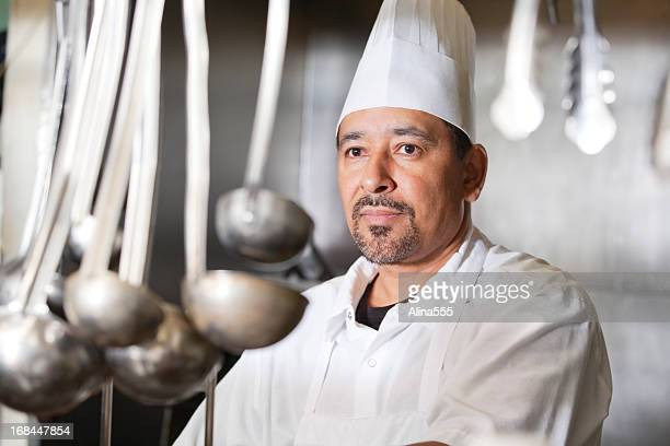 Portrait of a serious chef inside the restaurant kitchen