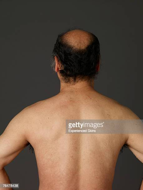 Portrait of a shirtless mature man, rear view