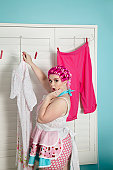Portrait of a shocked plus-size woman drying clothes