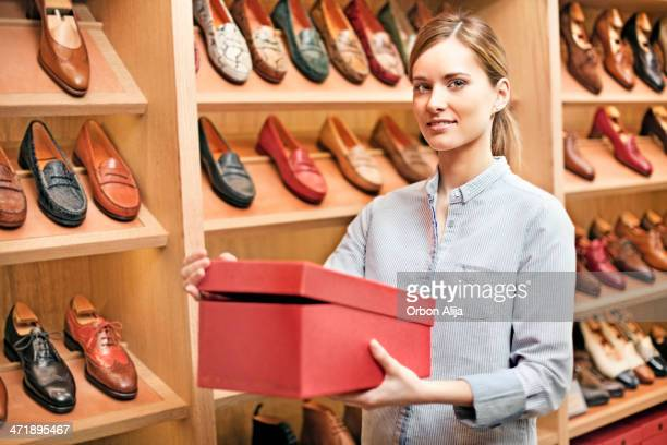 Portrait of a shoe store owner