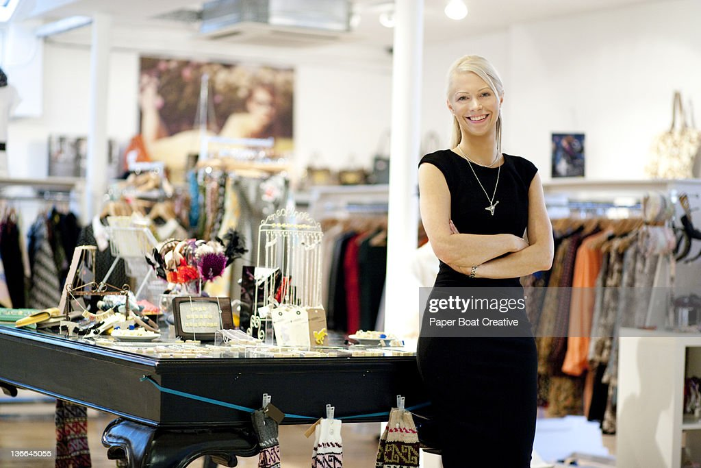 portrait of a shop owner standing proud : Stock Photo