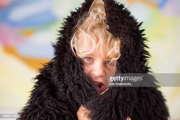 Portrait of a sixyearold boy with blond curls and a sheepskin on August 05 in Sankt Augustin Germany Photo by Ute Grabowsky/Photothek via Getty Images