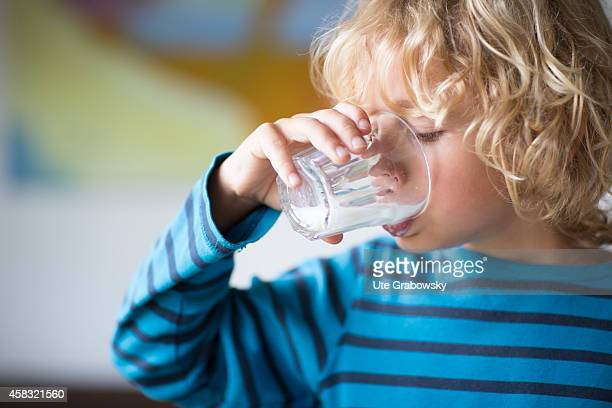 Portrait of a sixyearold boy with blond curls drinking milk on August 05 in Sankt Augustin Germany Photo by Ute Grabowsky/Photothek via Getty Images