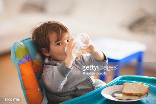 Portrait of a small boy drinking water : Foto de stock