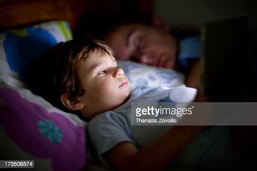 Portrait of a small boy looking a tablet : Stock Photo