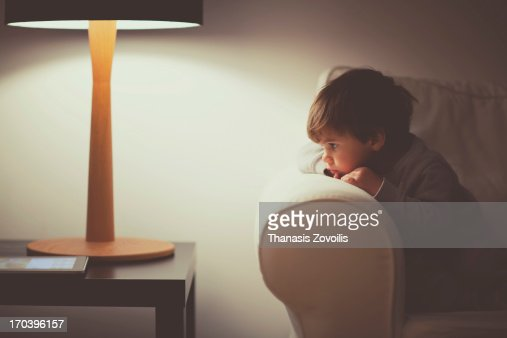 Portrait of a small boy looking at tablet