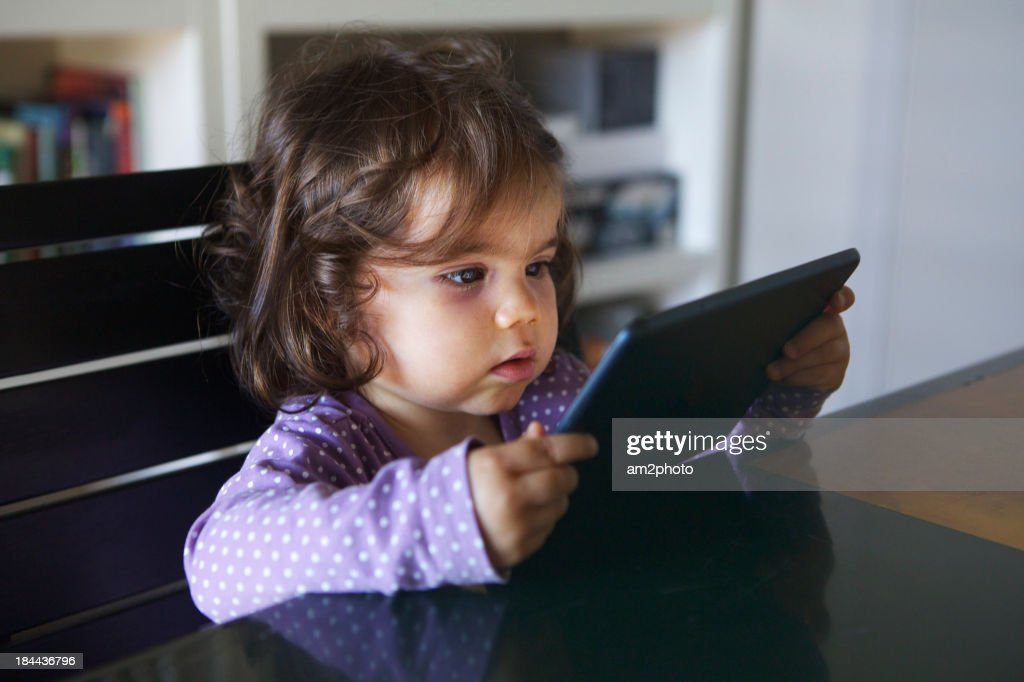 Portrait of a small girl using a tablet : Stock Photo