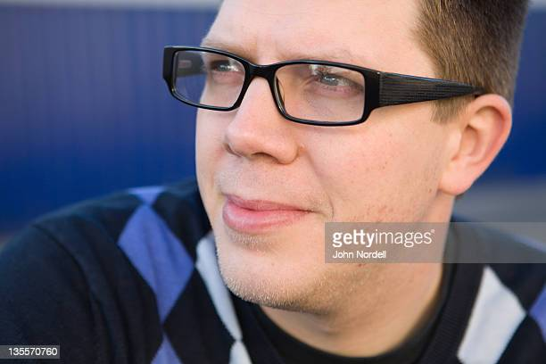 Portrait of a smiling 30-something Caucasian male looking out to his right