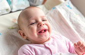 Portrait of a smiling baby laying on a changing table
