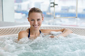 Portrait of a smiling beautiful woman in a hot tub