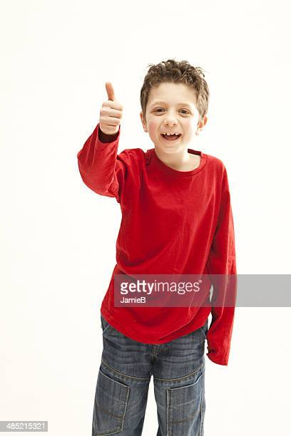 Portrait of a smiling boy giving a thumbs up gesture