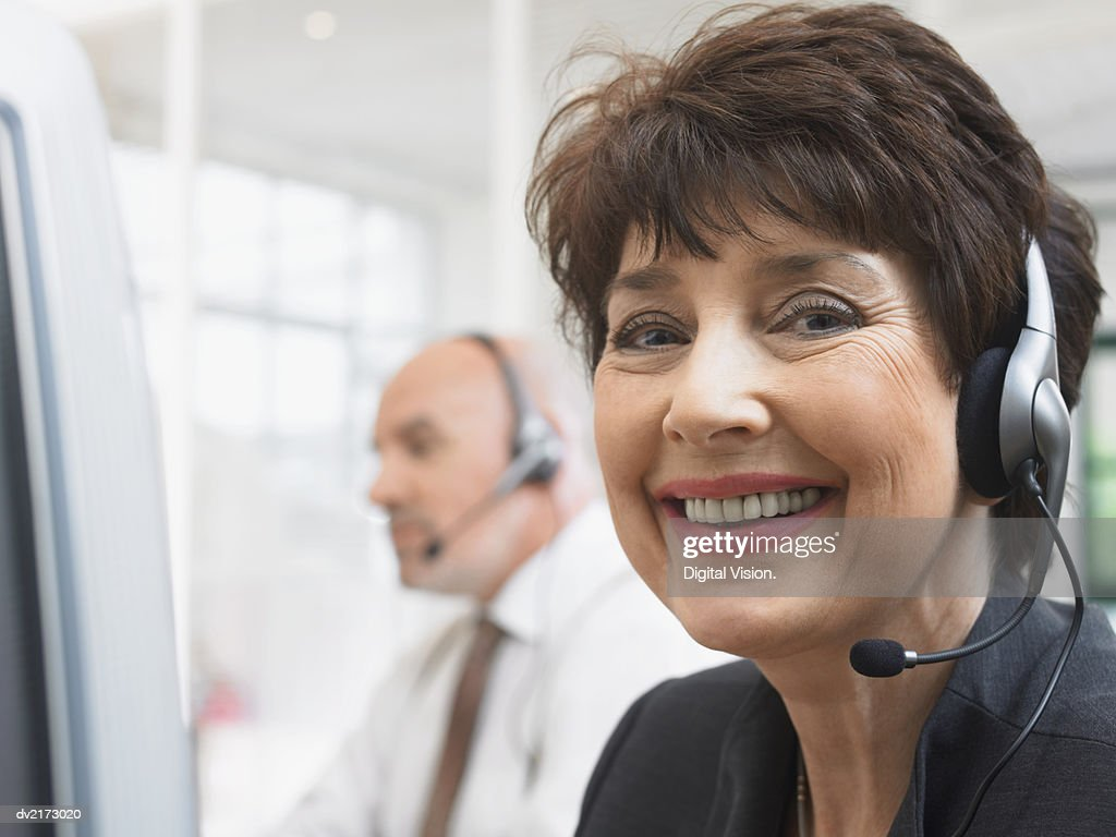 Portrait of a Smiling Businesswoman Wearing a Headset : Stock Photo