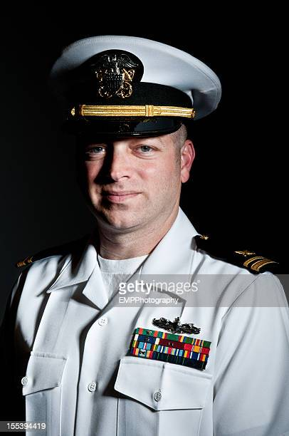 Portrait of a Smiling Caucasian Naval Officer Isolated on Black