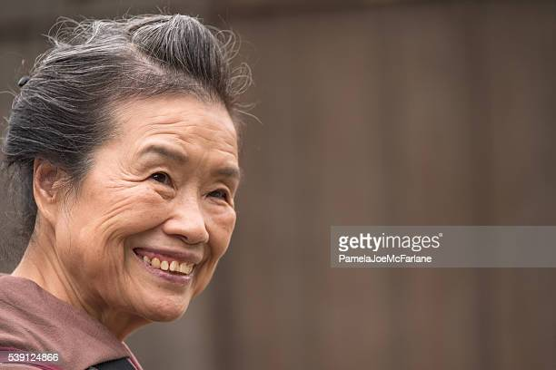 Portrait of a Smiling, Confident, Senior Japanese Woman with Copyspace