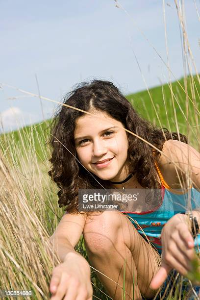Portrait of a smiling girl on a meadow