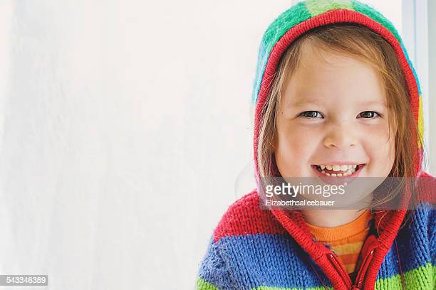 Portrait of  a smiling girl wearing a striped hoodie