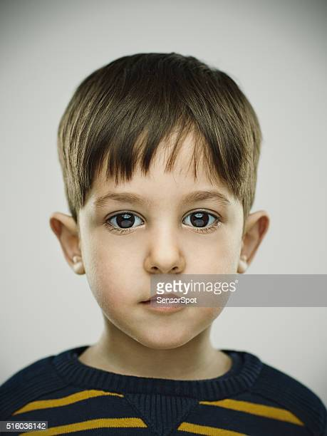 Portrait of a smiling kid looking at camera.