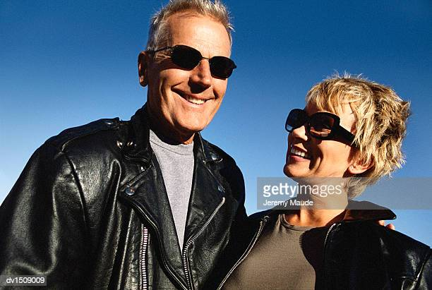 Portrait of a Smiling Mature Couple Wearing Leather Jackets