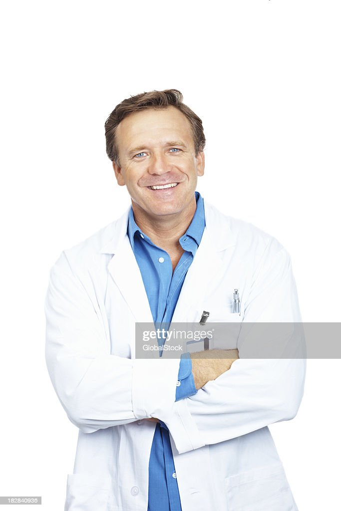 Portrait of a smiling mature doctor standing against white background : Stock Photo