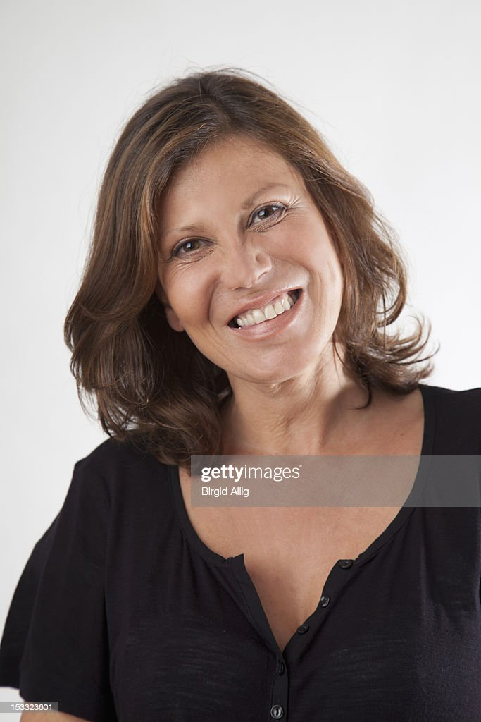 Portrait of a smiling mature woman : Stock Photo