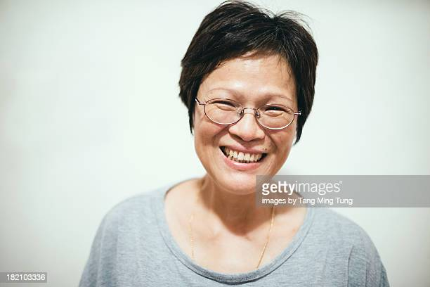Portrait of a smiling middle age chinese woman