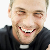 portrait of a smiling priest