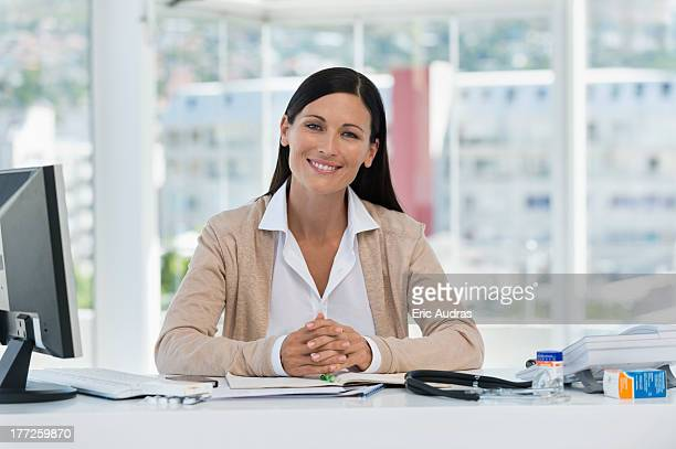 Portrait of a smiling receptionist in a doctor's office