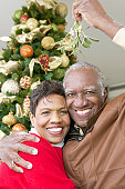 Portrait of a Smiling, Senior Couple Standing Under the Mistletoe