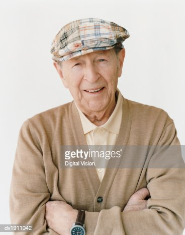 Portrait of a Smiling, Senior Man Standing With His Arms Crossed : Stock Photo