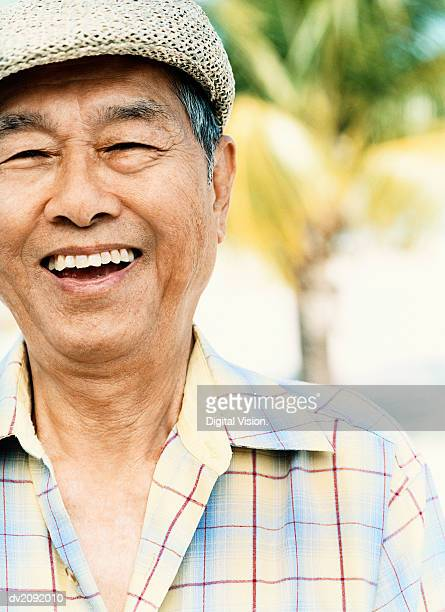 Portrait of a Smiling Senior Man Wearing a Flat Cap