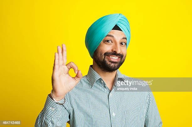 Portrait of a smiling Sikh man gesturing