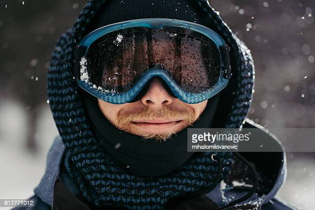 Portrait of a smiling snowboarder
