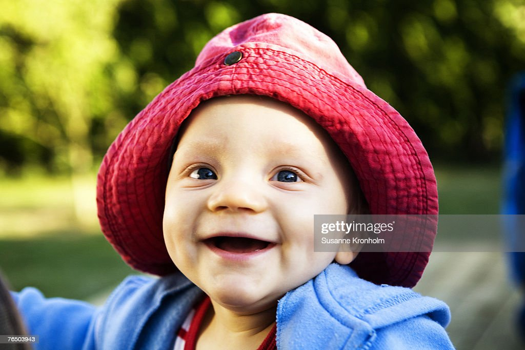 Portrait of a smiling Swedish baby boy.