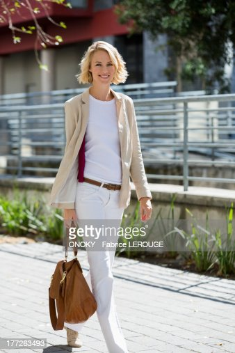 Portrait of a smiling woman walking on a street
