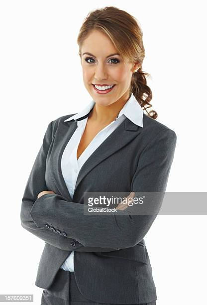 Portrait of a smiling young businesswoman with arms crossed