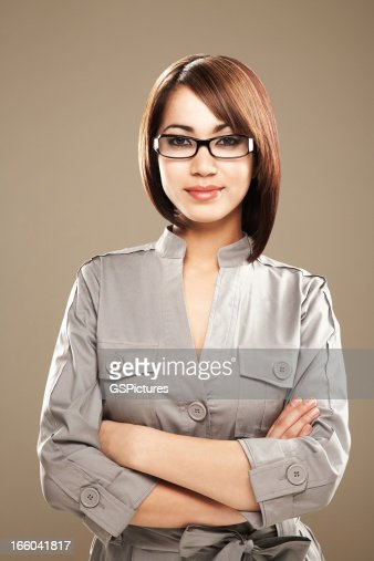 Portrait of a smiling young ethnic business woman in spectacles