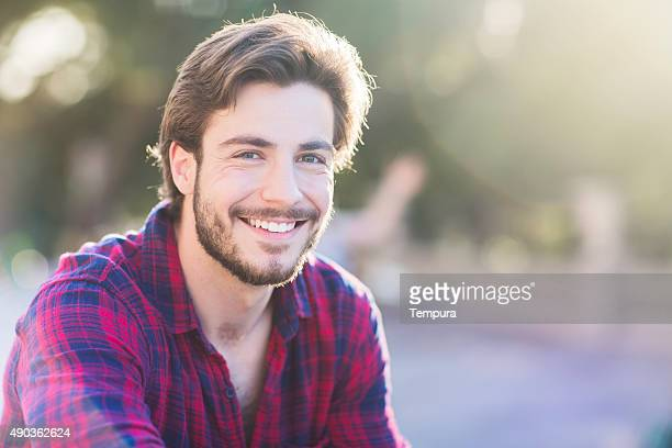 Portrait of a smiling young man in Barcelona.